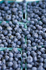 close up of blueberries in containers