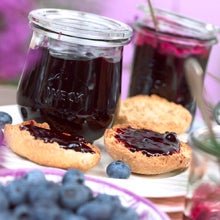 jar of blueberry jam and english muffins