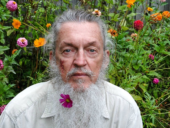 man with flower in his beard