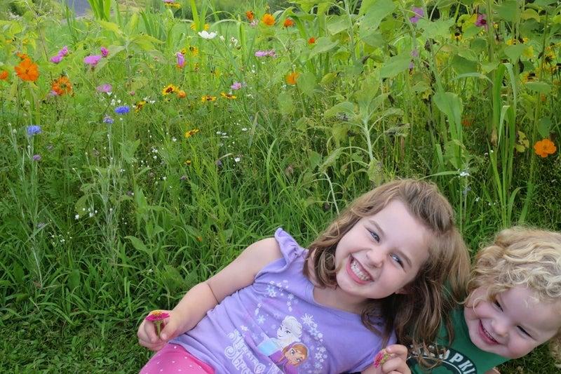 two girls in a wildflower meadow