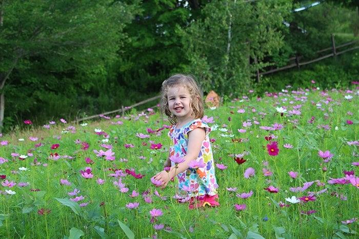 girl in a wildflower meadow